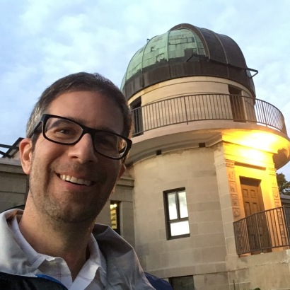 Dean Regas in front of the Drake Municipal Observatory in Des Moine, Iowa