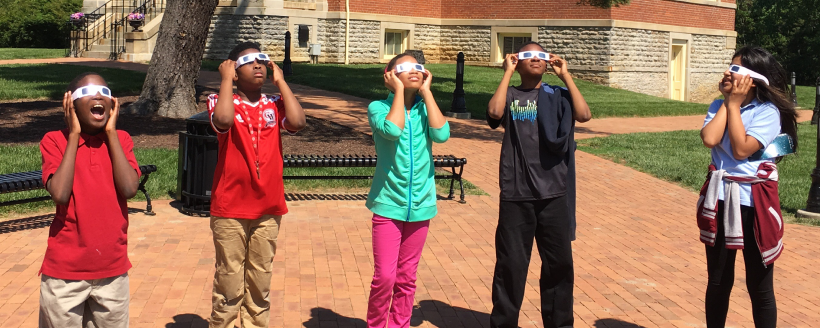 kids looking at an eclipse
